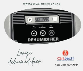 Large dehumidifier has operating panel.